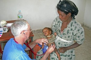 Phil Stillman with baby in Ethiopia